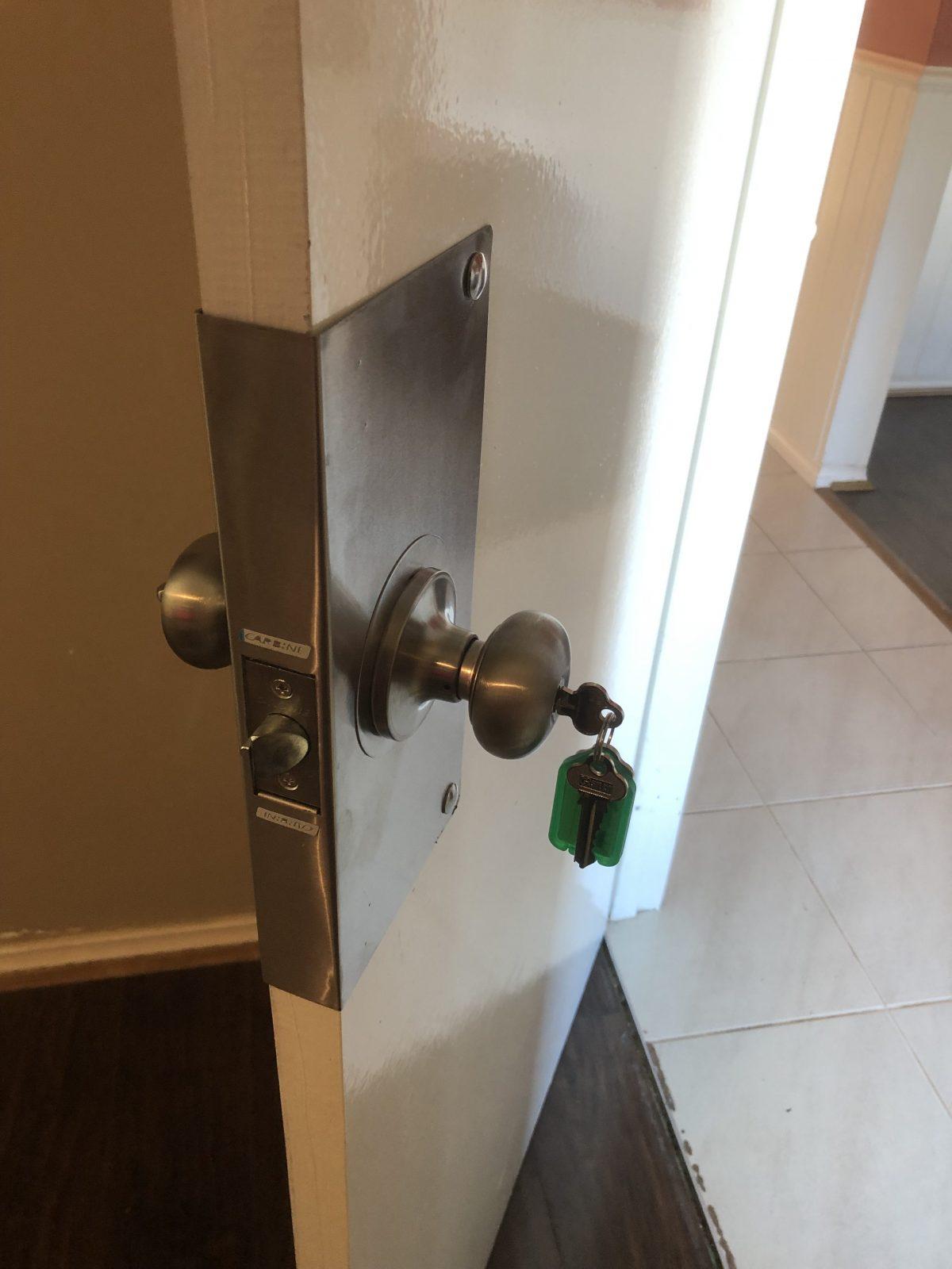 Installation of a wrap around door protection plate after door was broken in to in Wellard